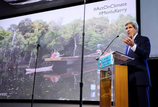 U.S. Secretary of State John Kerry gestures during a speech on climate change in Jakarta