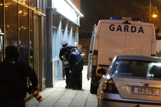 16/02/14 Garda attend the Scene at the plaza hotel Tallaght this evening. Pic Collins Photos
