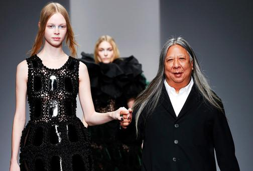 Designer John Rocha (R) walks alongside a model on the runway of the John Rocha show during London Fashion Week AW14 at Somerset House on February 15, 2014 in London, England Photo by Tristan Fewings/Getty Images