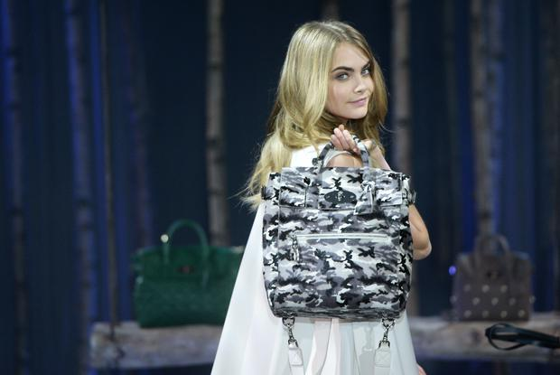 Model Cara Delevingne poses at a photocall to launch the Mulberry Cara Delevingne Collection during London Fashion Week at Claridge's Hotel