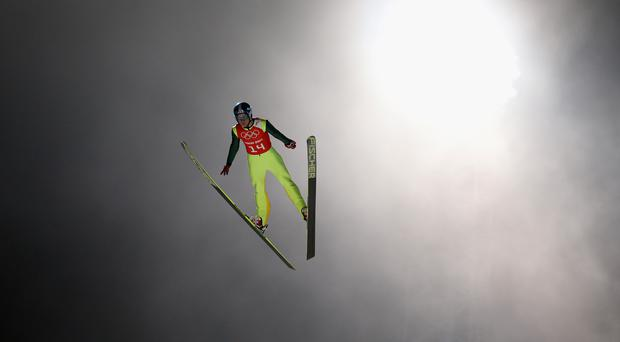 SOCHI, RUSSIA - FEBRUARY 16: Dusty Korek of Canada jumps during the Ski Jumping Men's Large Hill Official Training on day 9 of the Sochi 2014 Winter Olympics at RusSki Gorki Jumping Cernter on February 16, 2014 in Sochi, Russia. (Photo by Robert Cianflone/Getty Images)