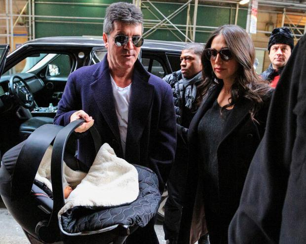 NEW YORK, NY - FEBRUARY 16: Simon Cowell with his partner Lauren Silverman and newborn son Eric Cowell are seen at their hotel on February 16, 2014 in New York City. (Photo by Alessio Botticelli/GC Images)