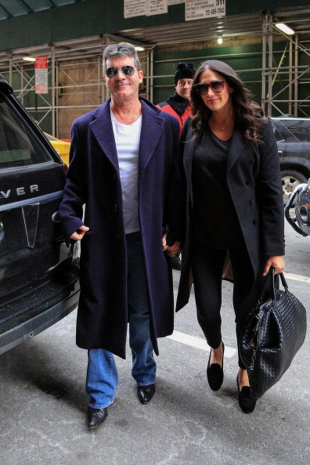 Simon Cowell with his partner Lauren Silverman and newborn son Eric Cowell are seen arriving at their hotel on February 16, 2014 in New York City. (Photo by Alessio Botticelli/GC Images)