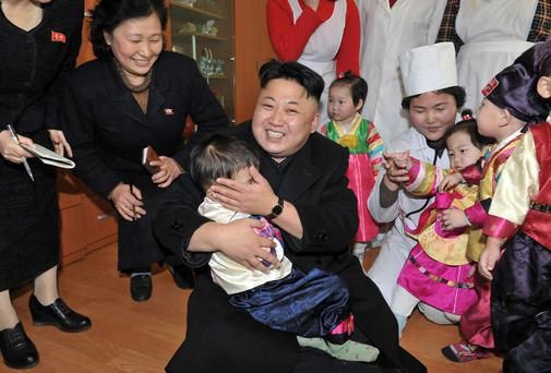 North Korean leader Kim Jong Un visits an orphanage in this undated photo released by North Korea's Korean Central News Agency (KCNA) in Pyongyang