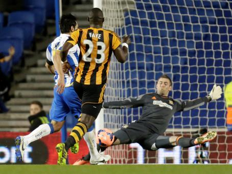 Brighton and Hove Albion's Leonardo Ulloa (L) shoots and scores his goal past Hull City goalkeeper Allan McGregor (R) during their English FA Cup fifth round soccer match at Falmer Stadium in Brighton.