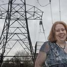 Flash Bristow stands near a electric pylon close to her house in Leytonstone, East London. Photo: Will Oliver
