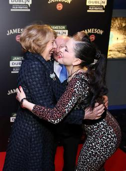 President Michael D. Higgins and wife Sabrina are welcomed to Cineworld Cinemas in Dublin by Imelda May before a festival screening of Inequality for All as part of the Jameson Dublin International Film Festival. Photo: Sasko Lazarov/Photocall Ireland/PA Wire