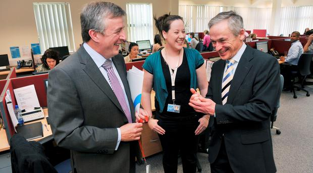 CEO of SouthWestern Jim Costello; team member Victoria Burgess and Minister for Jobs, Enterprise and Innovation Mr. Richard Bruton T.D. pictured at a previous announcement that Cork company, SouthWestern, was to create 150 new jobs.