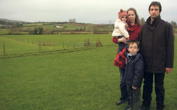 Metres from a proposed pylon site – Knockmore farmer Dermot McHale and his family, wife Aileen, son Patrick, and daughter Aisling. Picture: Henry Wills