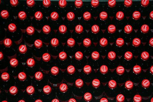 Bottles of Coca-Cola move along a production line