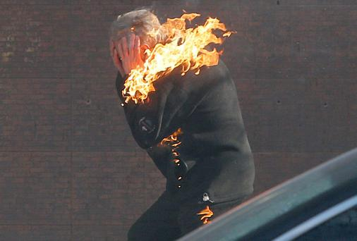 A anti-government protester is engulfed in flames while running from the scene, during clashed with riot police outside Ukraine's parliament in Kiev, Ukraine, Tuesday, Feb. 18, 2014. (AP Photo/Efrem Lukatsky)