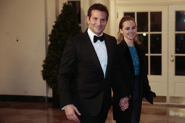 Actor Bradley Cooper, left, and Suki Waterhouse arrive to a state dinner hosted by U.S. President Barack Obama and U.S. first lady Michelle Obama