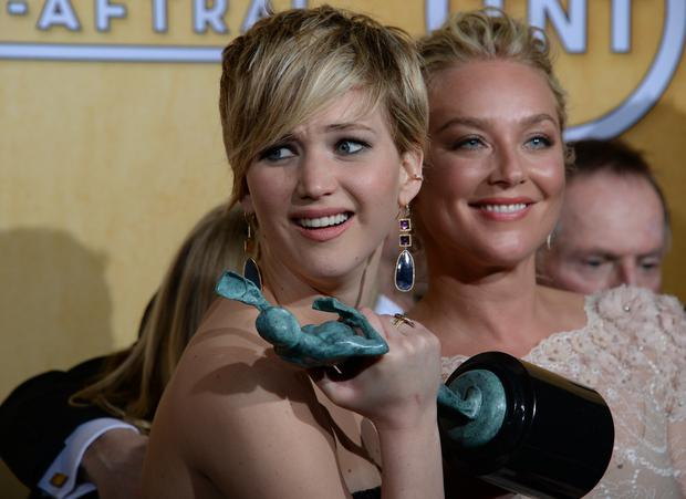 Jennifer Lawrence accepts her Best Cast in a Motion Picture gong for American Hustle at the SAG Awards