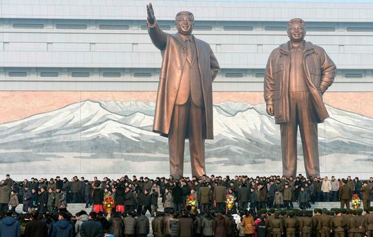 North Koreans gather in front of bronze statues of North Korea's founder Kim Il Sung, left, and late leader Kim Jong Il at Mansudae in Pyongyang, in this photo provided by Kyodo February 16, 2014, on the birthday of their late leader, Kim Jong Il. Photo: Reuters/Kyodo