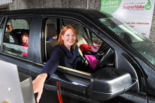 Busy mum Emer Murphy with her three children Rory (4), Kate(3) and Sarah Jane (6 months) launching the first ever 'Drive Through' service in Ireland in SuperValu Carrigaline, Co. Cork.