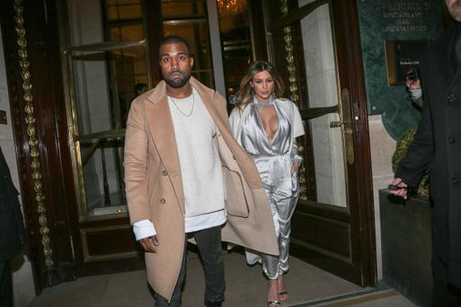 PARIS, FRANCE - JANUARY 21: Kanye West and Kim Kardashian leave the 'Meurice' hotel on January 21, 2014 in Paris, France. (Photo by Marc Piasecki/FilmMagic)