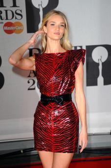 LONDON, ENGLAND - FEBRUARY 19: Model Rosie Huntington-Whiteley attends The BRIT Awards 2014 at 02 Arena on February 19, 2014 in London, England. (Photo by Anthony Harvey/Getty Images)
