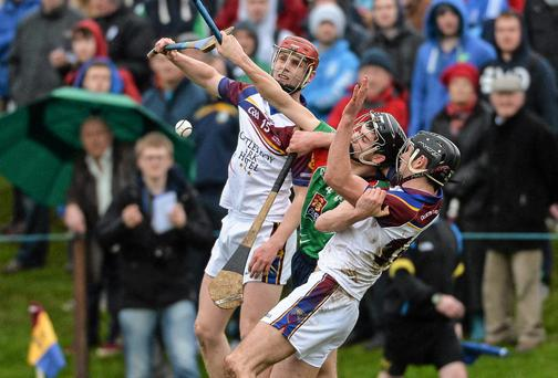 Cian Nolan, Limerick IT, in action against Tommy Heffernan, left, and Cathal Malone, University of Limerick