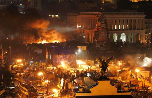 Smoke rises above burning barricades at Independence Square during anti-government protests in Kiev February 20, 2014