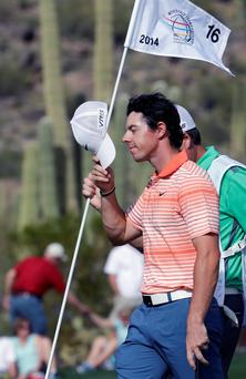 Rory McIlroy, of Northern Ireland, waves after winning his match against Boo Weekley during the first round of the Match Play Championship golf tournament on Wednesday, Feb. 19, 2014, in Marana, Ariz. (AP Photo/Ted S. Warren)
