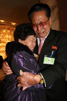North Korean Lee Yun-geun, 72, hugs his South Korean sister Lee Sun-hyang, 88, during their family reunion at the Mount Kumgang resort in North Korea. The six days of family reunions take place under the cloud of a U.N. report on human rights abuses in North Korea, which investigators have said were comparable to Nazi-era atrocities. A group of 100 South Koreans crossed the world's most heavily fortified border this morning, a frontier that separates two countries that remain at war after their conflict ended in an armistice rather than a peace treaty. Photo: Reuters/Lee Ji-eun/Yonhap