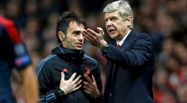 Arsenal's manager Arsene Wenger (R) reacts during the match against Bayern Munich