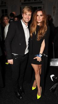 Kian Egan (L) and Jodi Albert is seen at Warner & Belvedere Post BRIT Awards party at The Savoy Hotel
