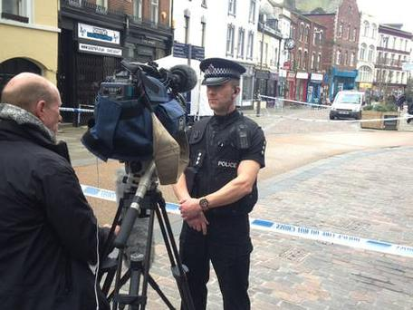 Chief Inspector Neil Smith of Gloucestershire Police speaks to media outside Fringe Benefits and La Bella Beauty on Southgate Street, Gloucester (PA)