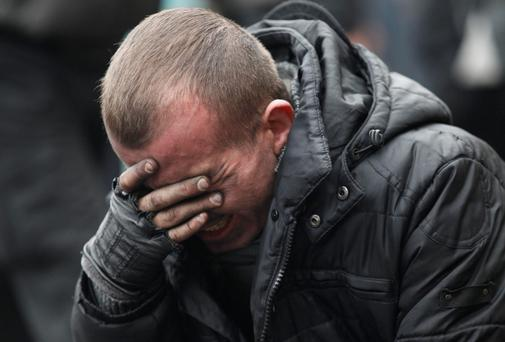 An anti-government protester reacts following clashes with riot police in Independence Square in Kiev. At least 21 civilians were killed in fresh fighting in Kiev on Thursday, shattering an overnight truce declared by Ukrainian President Viktor Yanukovich, and a presidential statement said dozens of police were also dead or wounded. Reuters