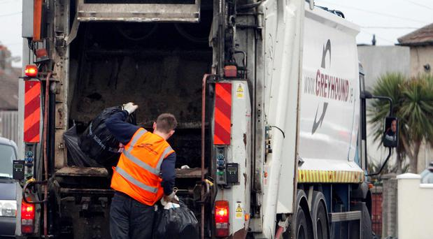 A file shot of Greyhound Bin truck collecting rubbish