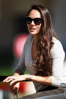 BAHRAIN, BAHRAIN - FEBRUARY 21: Jessica Michibata, girlfriend of Jenson Button of Great Britain and McLaren sits in the paddock during day three of Formula One Winter Testing at the Bahrain International Circuit on February 21, 2014 in Bahrain, Bahrain. (Photo by Mark Thompson/Getty Images)