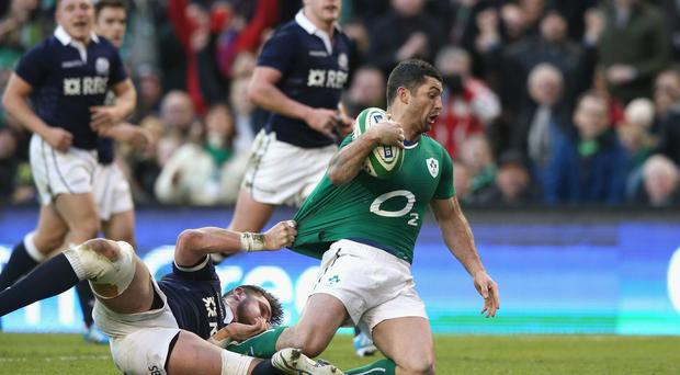Rob Kearney of Ireland dives over for a try during the match between Ireland and Scotland