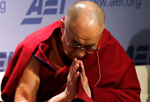 The Dalai Lama greets the audience at the American Enterprise Institute in Washington on Thursday night. Reuters