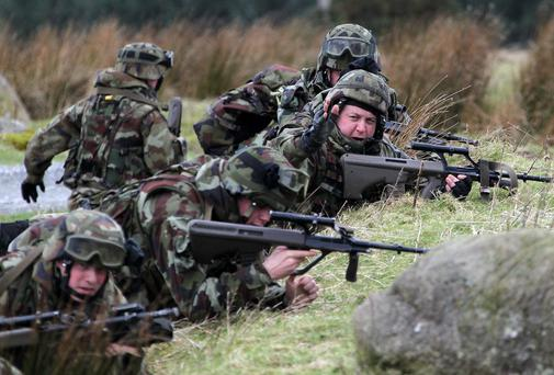Soldiers lay down covering fire during an aerial extraction exercise in which 129 Defence Forces soldiers from the 44 Infantry Group entered the final phase of intense training in preparation for their forthcoming deployment to the United Nations Disengagement Observation Force