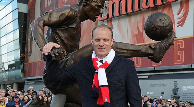 Denis Bergkamp alongside his bronze statue at the Emirates today