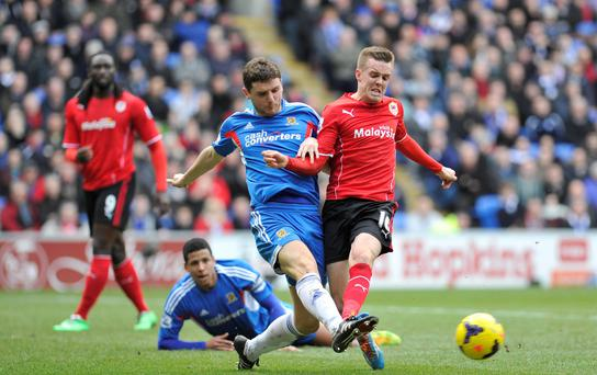 Cardiff City's Craig Noone and Hull City's Alex Bruce during the Barclays Premier League match at The Cardiff City Stadium, Cardiff