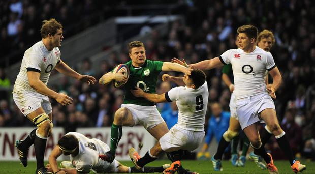Brian O'Driscoll of Ireland hands off Danny Care during Ireland's 13-10 defeat at Twickenham