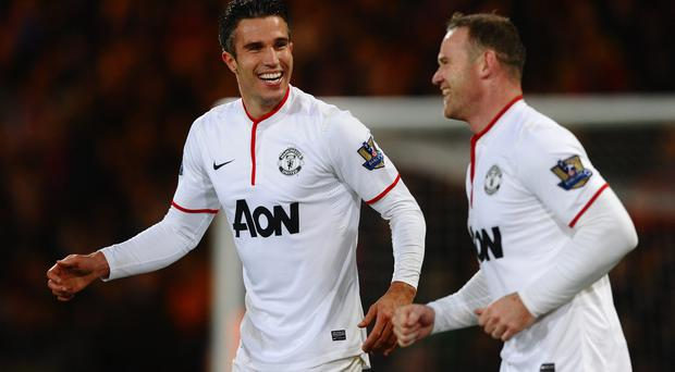 Robin Van Persie of Manchester United celebrates the first goal with Wayne Rooney