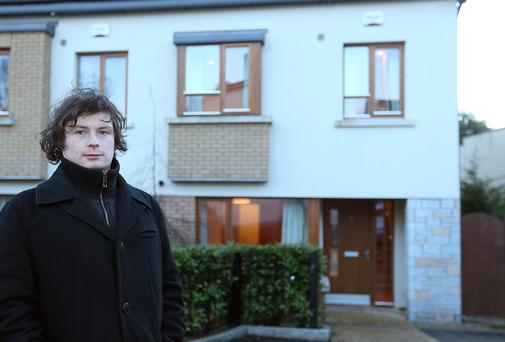 Reporter Luke Byrne outside a house for sale in the Cabinteely Wood estate, Cabinteely south Dublin. Picture: GERRY MOONEY.