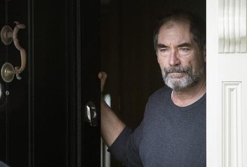 PRIME TARGET: Timothy Dalton answers his door yesterday. Photo: Tony Gavin.