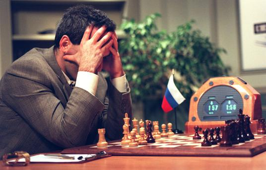 World Chess Champion Garry Kasparov looks at the chessboard before his next move in the early part of the fifth game against the IBM Deep Blue computer