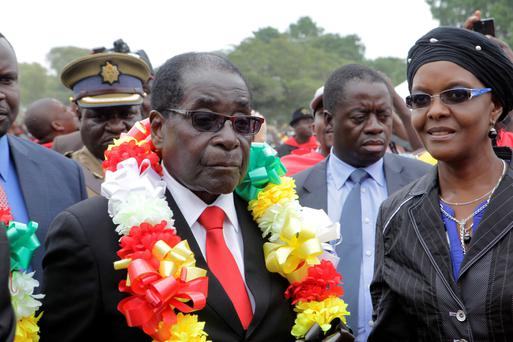Zimbabwe's President Robert Mugabe,left, and his wife Grace arrive for celebrations to mark his 90th birthday in Marondera, east of Harare