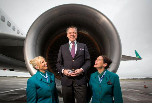 Christoph Mueller, Aer Lingus CEO, (centre) with Aer Lingus cabin crew Lesley Murphy and Grainne Frawley. Photo: Sean Curtin