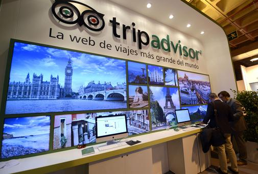 Visitors at the stand of TripAdvisor during the Madrid's International Tourism Trade Fair