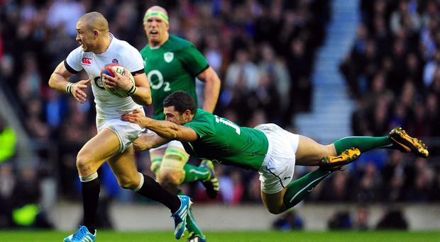 Ireland player Rob Kearney fails to halt England fullback Mike Brown from making a break to set up the winning try