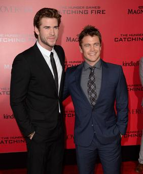 Actor Liam Hemsworth (L) and Luke Hemsworth arrive at the premiere of Lionsgate's