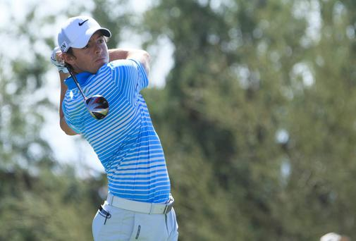 Rory McIlroy plays his tee shot on the 14th hole during the second round of the World Golf Championships