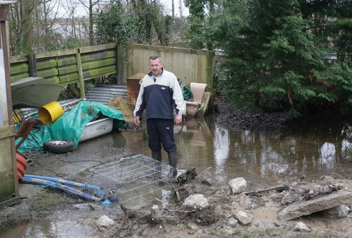 Homeowner John Stroud standing is his flooded garden in Athlone