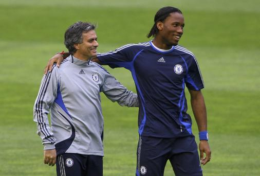 Chelsea Coach Jose Mourinho shares a joke with striker Didier Drogba in 2007