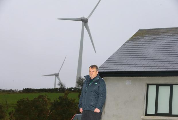 Philip Hickey, Ballindaggin, Co Wexford with wind turbines next to his house. Picture: Patrick Browne